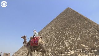 The Giza Pyramids and the Egyptian Museum in Cairo reopened Wednesday