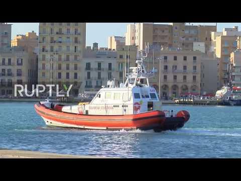 Italy: Coastguard ship carrying 'hijacker' migrants docks in Sicily