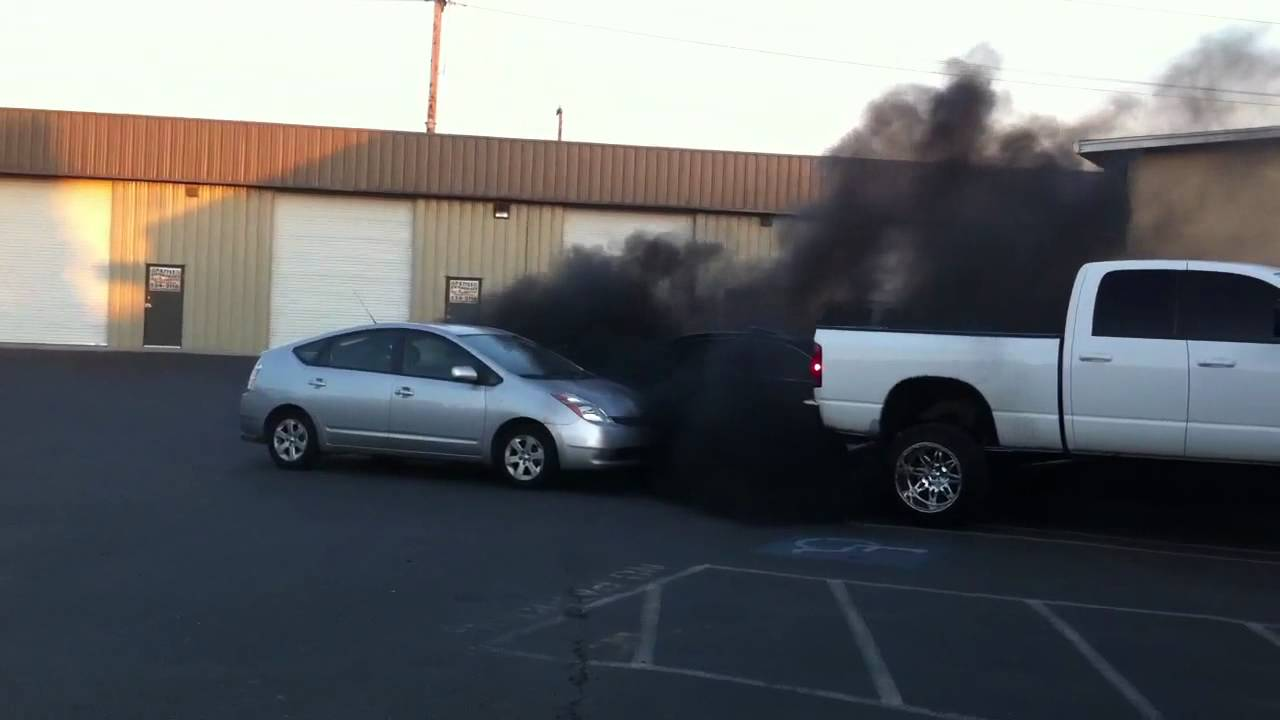 Image result for rolling coal on prius