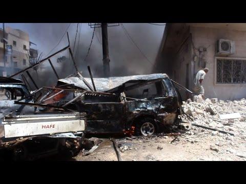 Observer group: 12 killed in strike on Syrian rebel-held town