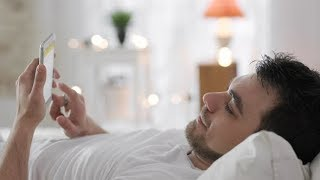 Young Man with Mobile Cell Phone Using Internet in Bed | Stock Footage - Videohive