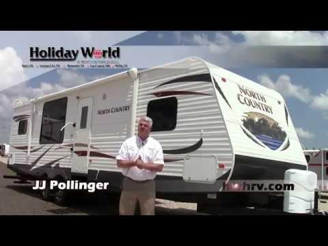 Preowned 2013 Heartland North Country 29RKSS Travel Trailer RV - Holiday World Katy, Texas