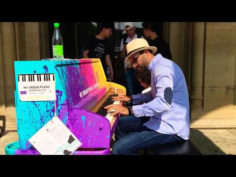 Playing Street piano at Place d'Armes in Luxembourg city improvising on a salsa tune