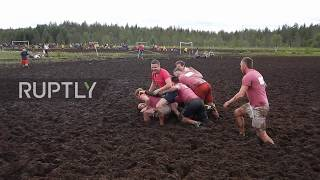 Playing dirty! Russian teams crowned winners of swamp football world champs