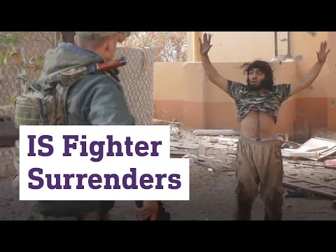 The moment an IS fighter surrenders to Kurdish forces