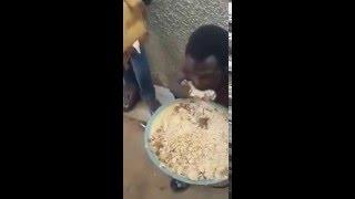 Funny kenyan man eating food