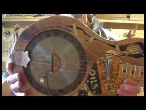 JUNKSVILLE SAW BLADE RESONATOR GUITAR THE PROSPECTOR LUMBERCASTER EDITION CIGAR BOX INSPIRED GUITAR