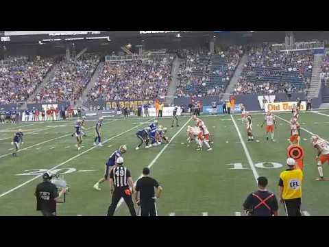 Winnipeg Blue Bombers vs BC Lions Andrew Harris jumps over Anthony Orange
