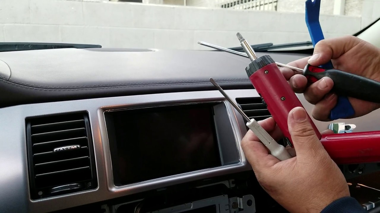 how to remove radio navigation display from jaguar xf 2011 for repair  part  2