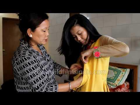Tibetan girl shows us how she wears a chupa dress