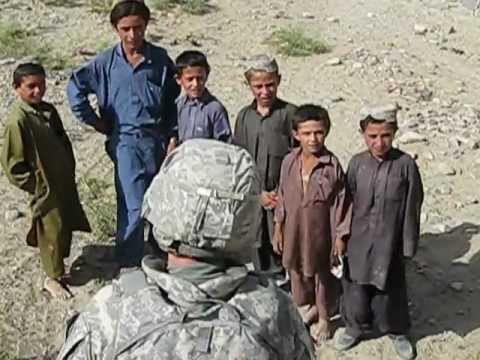 American Soldier Playing With Afghan Children