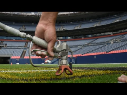 Paintin' Manning's Lawn: Turf Crew Paints the field at Sports Authority Field at Mile High