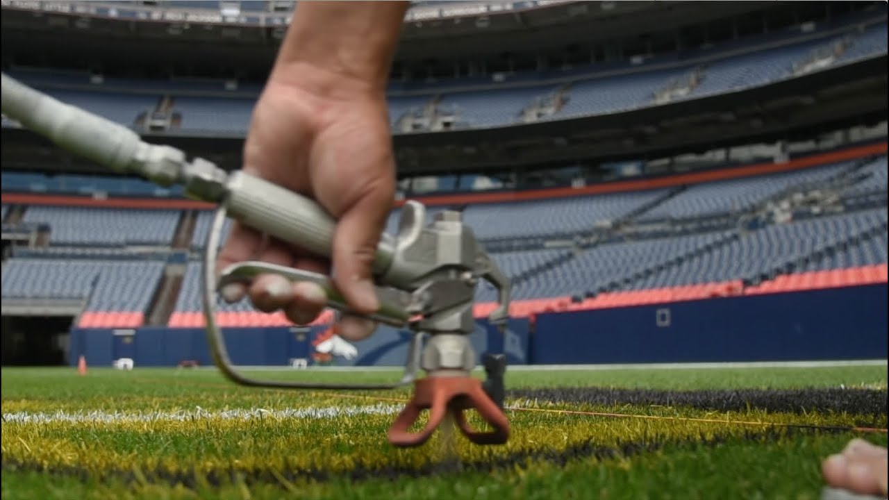 Paintin Manning S Lawn Turf Crew Paints The Field At Sports Authority Mile High You