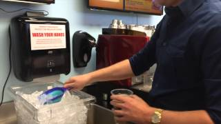 Iced coffee and the lid-sealing machine at Quickly