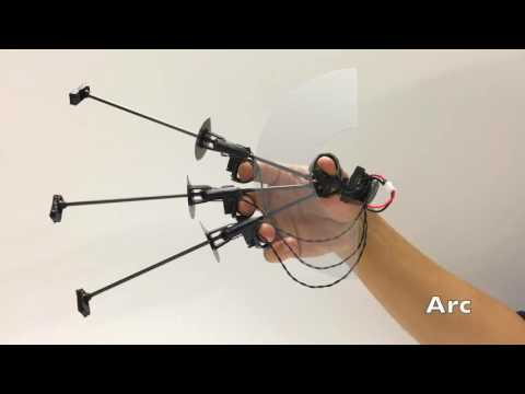 Wolverine: A Wearable Haptic Interface for Grasping in Virtual Reality
