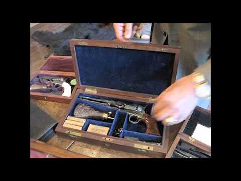 Fine and Exceptional Cased, Engraved and Relief Carved and Checkered Ebony-Gripped Colt Model...