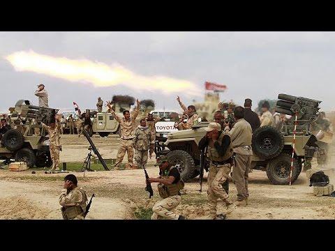 Thousands flee Tikrit battle