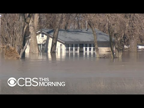 "Communities submerged by Midwest flooding: ""I was petrified"""