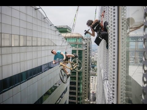 Stunt photoshoot off skyscraper with everyday atheletes
