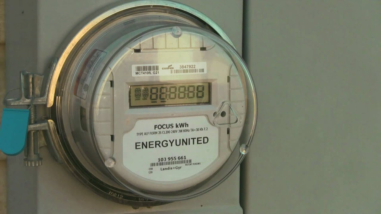 Digital Electric Meter : Digital meter spining backwards for less than