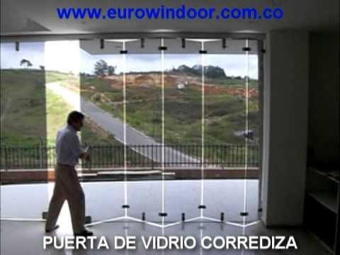 Puerta de vidrio corrediza youtube for Puertas corredizas