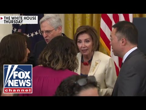 Video shows Pelosi maskless hugging people at crowded event