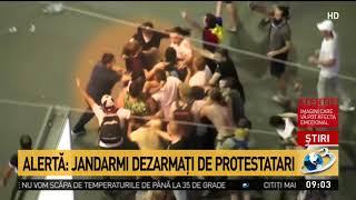 O femeie-jandarm și colegul ei, bătuți minute în șir de protestatari