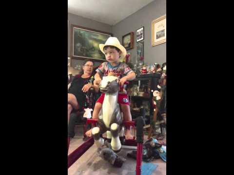 Lil Josh's new radio flyer horse from Santa