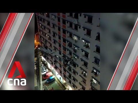 Firefighters rescue two men standing on window ledge after fire breaks out in Bukit Batok flat