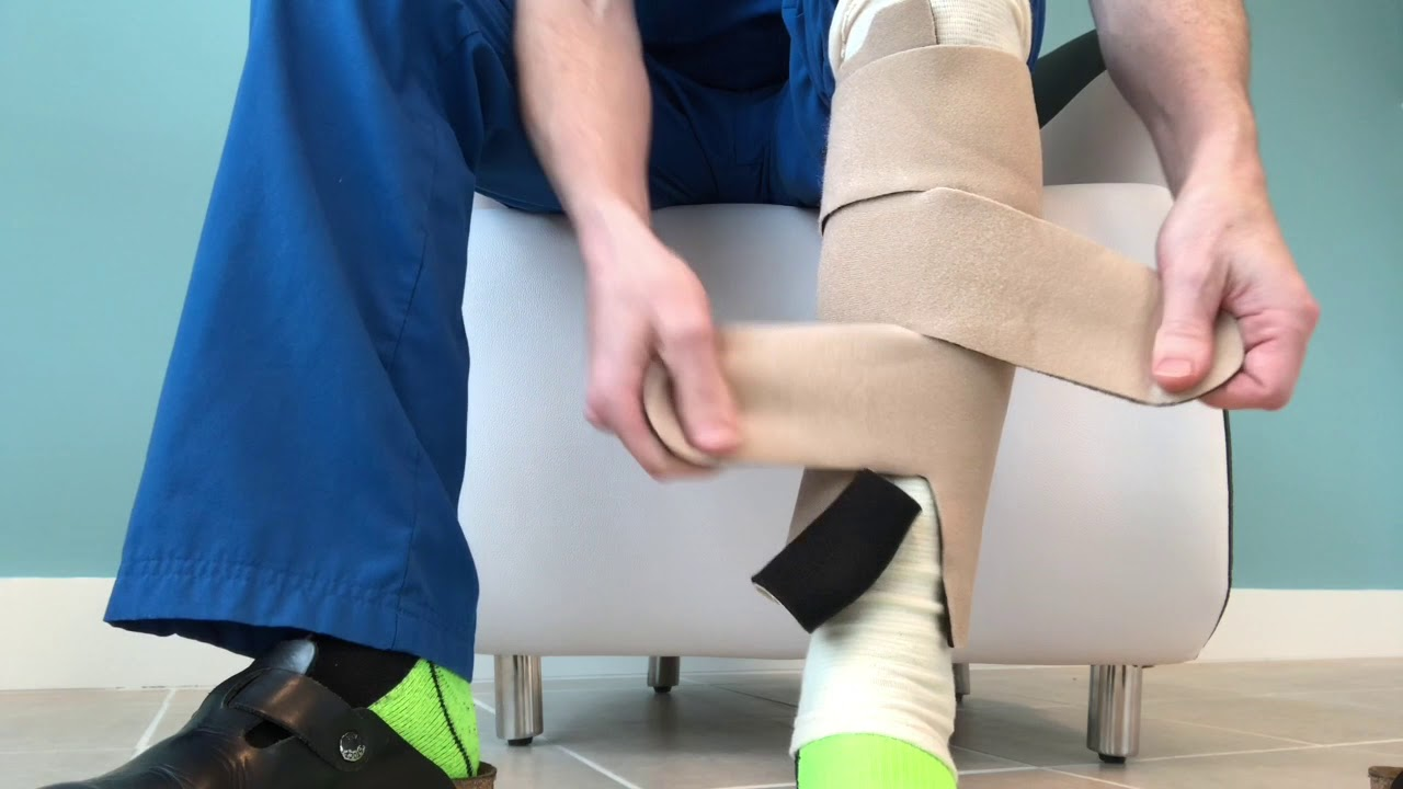 00ca93672e How to put on Juzo compression wrap for lower leg - YouTube