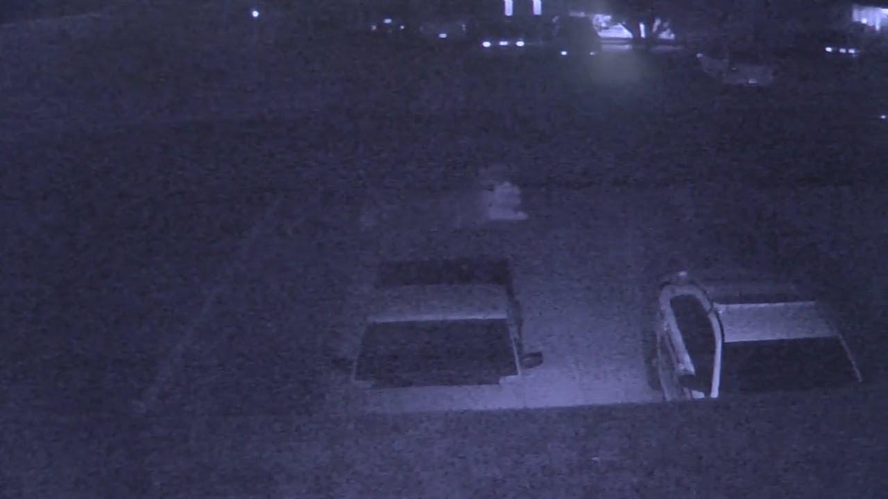 Download Creepy image caught gliding across surveillance camera