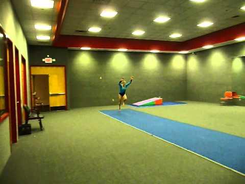 50 year old gymnast doing a tumbling run