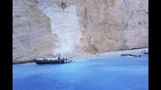 Navagio Beach tourist, Zakynthos rock beach, tourist beach in Greece