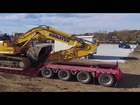 Globe Trailers: 55 Ton Lowboy w/ Hydraulic Flip axle on job site