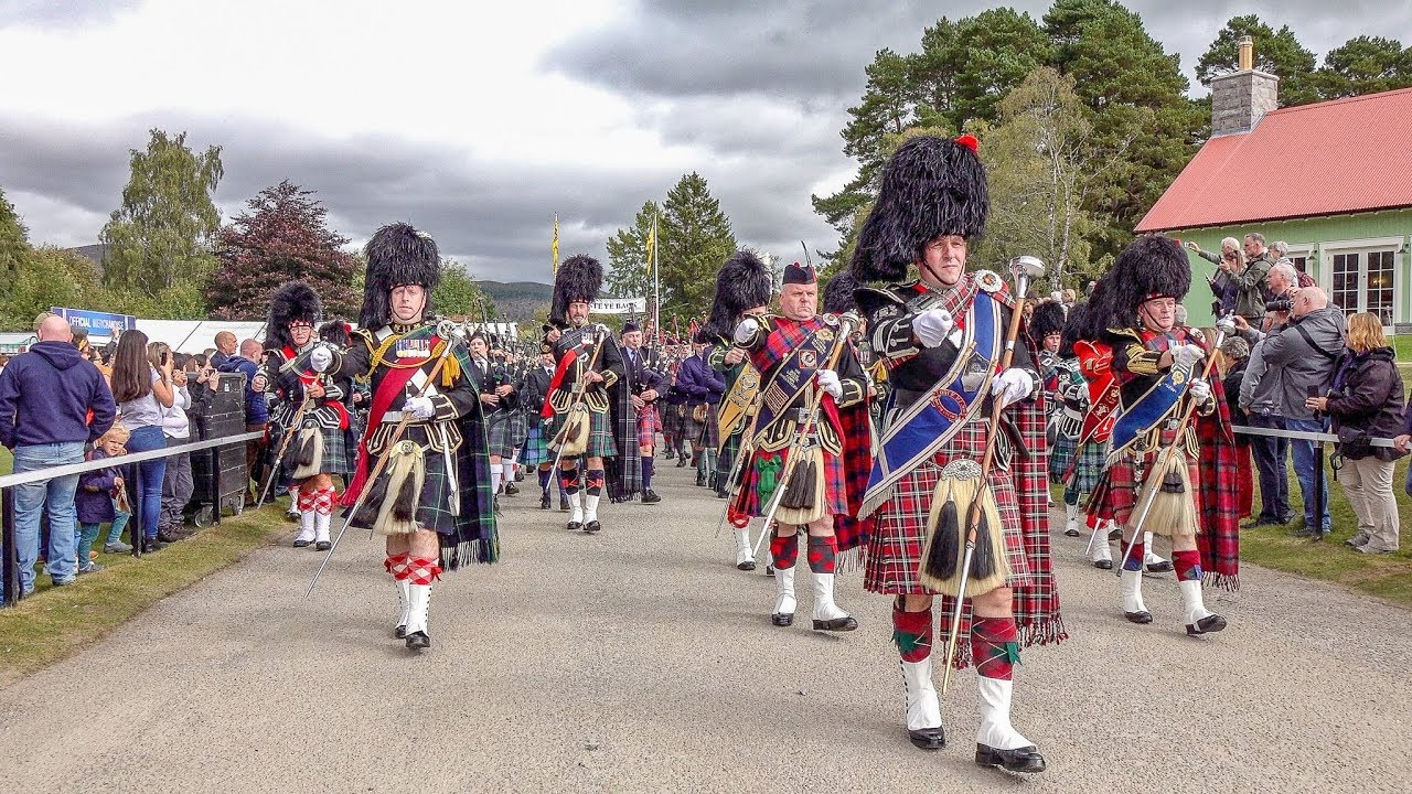 Download Massed pipes & drums parade to the 2018 Braemar Gathering Royal Highland Games in Scotland (4K)