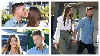 Taylor Hill and boyfriend Michael Shank share a sweet kiss as they appear on Extra