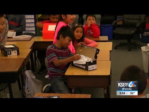 Students at Santa Maria elementary school receive donated shoes