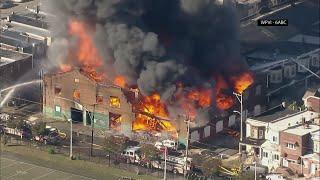 Flames tear apart Philadelphia auto body shop