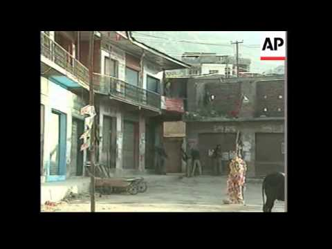 2 dead after suspected militants attack polling station