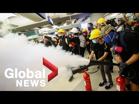 Hong Kong protesters standoff against police after sit-in at Yuen Long station