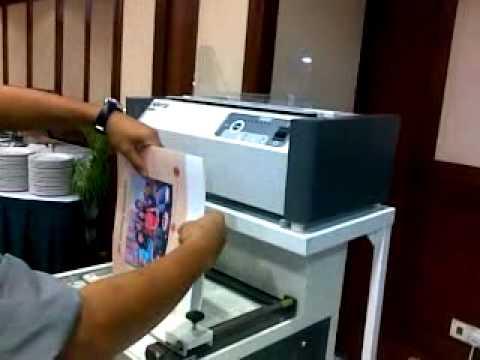 Printing photo enlargements at Costco Photo Center Noritsu photo book machine