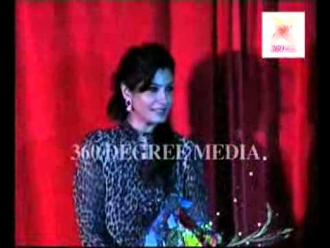 Actress Raveena Tandon felicitated and called on stage at the launch of a magazine issue