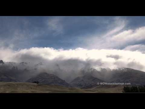 Nor' wester rolling over the Pisa range near Cromwell, Central Otago