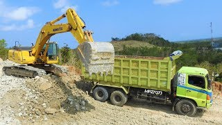 Komatsu PC300 Excavator Loading Dirt Into Dump Truck On Quarry