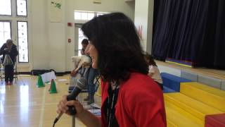 Longmeadow Center School principal Donna Hutton puckers up to kiss lizard in honor of kids' reading