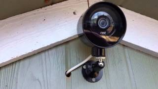 Unboxing outdoor case and installing Nest camera outside.
