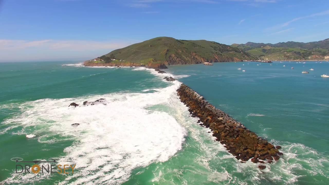 Waves Crashing Over A Jetty Near Lighthouse Avila Beach