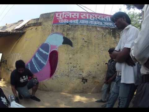 Painting the side of a police station - Agra, India 2012