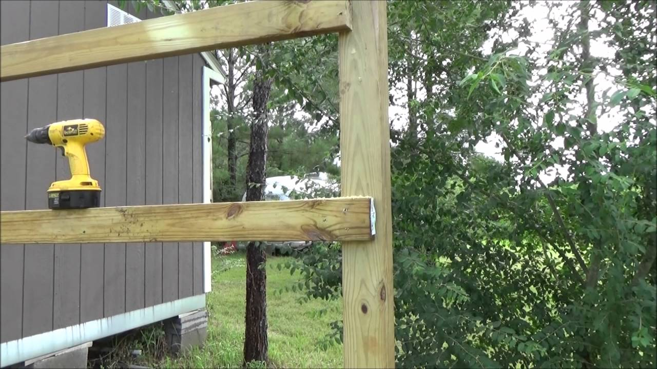 setting the rails on a wood privacy fence