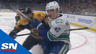 Matt Grzelcyk Drills Elias Pettersson Into The Boards With Late Hit, No Penalty Called